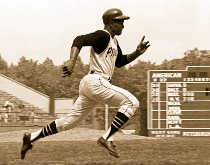 Clemente runs after a hit in Forbes Field.