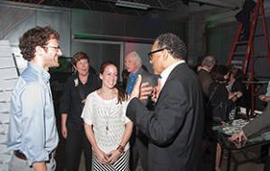 Huff talks with students and guests at the Charleston center's 25th anniversary celebration in May.