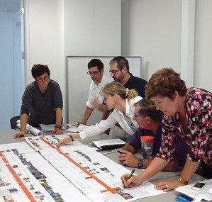 Members of the centennial committee collaborate on a timeline of the architecture program's first century.