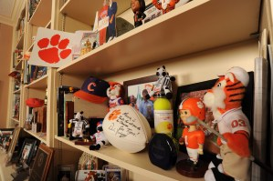 The shelves in the library at the President's Home offer a quick review of the Barkers' Clemson experience.