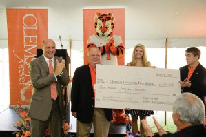 President Clements applauds as Class of 1964 member Doug Richardson presents the class gift for scholarships and the Academic Success Center. Students Abby Holcombe and Parker Leyland spoke at the event as recipients of help from the center.