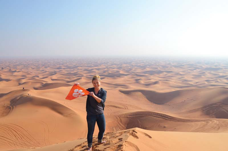 "United Arab Emirates: Heather Britt '14 shows her Tiger pride while ""dune bashing"" in the Dubai desert."