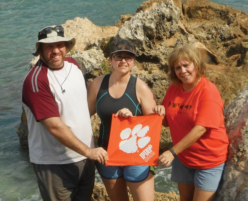 Haiti Robert '98 and Walker Massey, and Debbie Peek show off a Tiger Rag in a Caribbean cove.