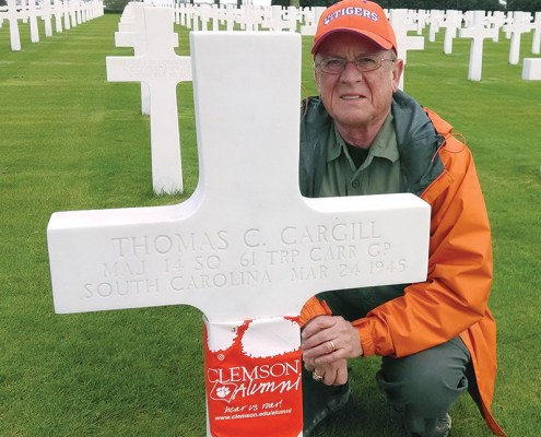 Netherlands David Lyle '68, M '79 honored fallen Clemson alumni with Tiger Rags at the Netherlands American Military Cemetery.