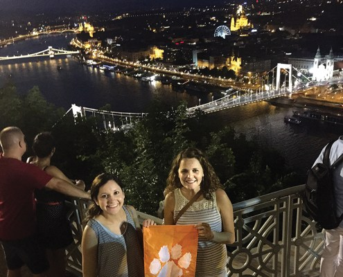 Hungary Stephanie Beard M '14 and Sarah Worachek '07 wave their Tiger Rag over Budapest at the Citadalla.