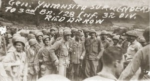 "A photo taken by Lt. William H. Thackston '39 shows Imperial Japanese Army Gen. Tomoyuki Yamashita ""The Tiger of Malaya"" (center) posing with American soldiers at his surrender to U.S. forces (photo courtesy of the Thackston family)."