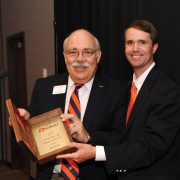 Jim Bull (left) receives the Volunteer of the Year award from Wil Brasington, executive director of Alumni Relations.