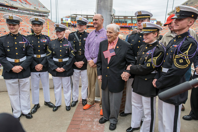 Ben Skardon with President Clements and Army ROTC cadets