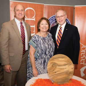 President Clements with Sheila and Waenard Miller, M.D. The Millers received a platter crafted of wood from a tree that once stood on Clemson's campus.