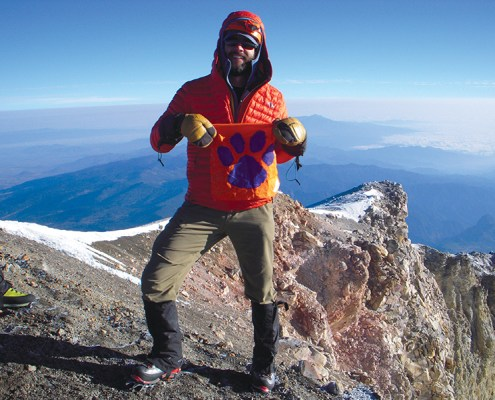 Rhett Mitchell III '05 shares his second-generation Tiger Rag at the top of Pico de Orizaba, 18,491' elevation. The Tiger Rag is from Rhett Mitchell Jr. '79* who has owned it since 1975.