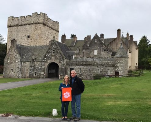 Karen Burns '78 shows some Tiger spirit at Drum Castle in Scotland with her husband Randy.