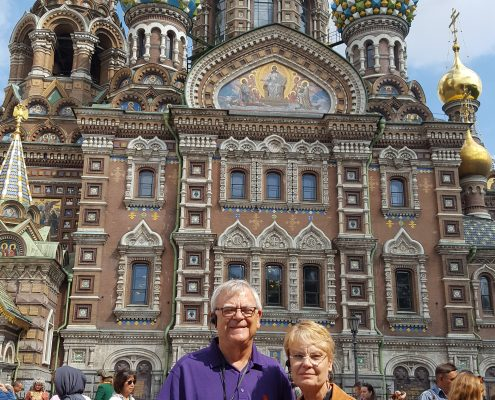 Charles Elfert '67 and his wife Gail in front of the Church of the Savior on Spilled Blood in St. Petersburg, Russia.