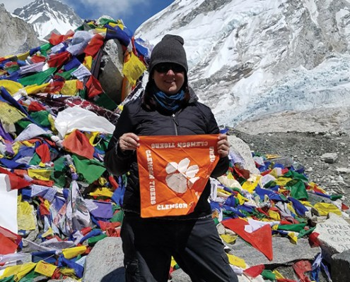 Megan Lunn '06, after landing at Lukla, one of the world's most dangerous airports, hiked eight days to Mount Everest's Base Camp, an elevation of 17,600 feet, waving her Tiger Rag to celebrate her accomplishment.