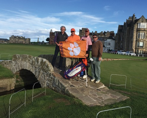 Ray Massey '92, Dave Christensen, Chad Blackston '04 and Tom Wyatt posed on the iconic Swilcan Bridge with their Clemson golf gear at the Old Course in St Andrews, Scotland.