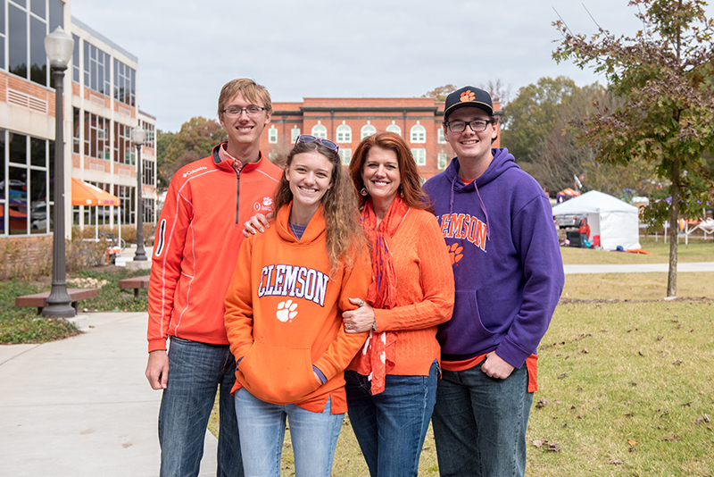 Charlie Blackwell-Thompson at a Clemson home game with her children, Matt, Lhotse and Cody.