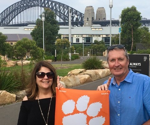 "Australia: Charlotte Cobb '91 and her husband, Stephen, celebrate the National Championship win in Sydney: ""We were in Santa Clara for the National Championship game and flew out to Sydney the next day."""