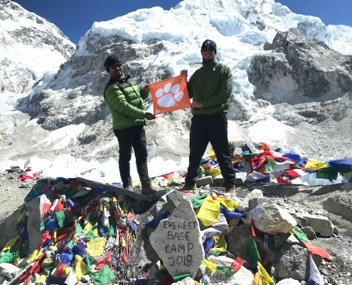Nepal: Victor Quintero '14, right, hiked to Mount Everest Base Camp, which sits at 17,600 feet, with his guide, Jamling, in October 2018.
