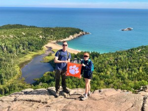 """Maine: Amanda Hrubresh '13 and Collin '16 Clemons hiked Beehive Trail in Acadia National Park. """"[Beehive Trail] is only 1.4 miles long, but you gain 488 feet in elevation and often climb up vertically on iron rungs, bridges, and hand and foot holds,"""" Amanda wrote."""