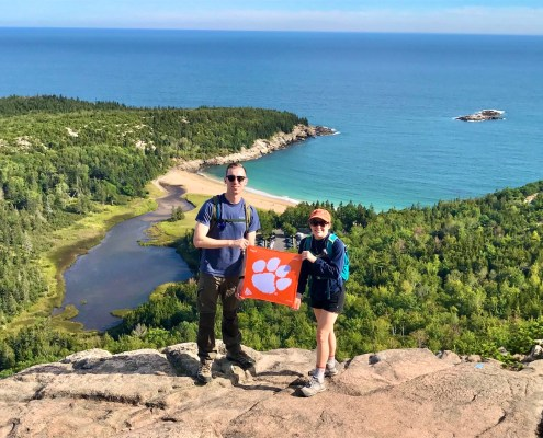 "Maine: Amanda Hrubresh '13 and Collin '16 Clemons hiked Beehive Trail in Acadia National Park. ""[Beehive Trail] is only 1.4 miles long, but you gain 488 feet in elevation and often climb up vertically on iron rungs, bridges, and hand and foot holds,"" Amanda wrote."