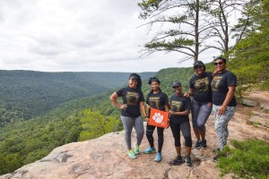 """Tennessee: From left to right, Candace Hall '10, Lyndsey Williams Mayweather '10, April Smith '08, Alexia Richardson '10 and Nyamekyer Sonja Badu '11 celebrated their 32nd birthdays in the mountains of Tennessee on a hiking trip led by fellow Clemson alum Ryan Maum '17, who owns and operates Experience Chattanooga. Ryan shot the photo of the group on the overlook of Cumberland Mountain. """"We celebrated our 19th birthdays together in Calhoun Courts and have been celebrating together ever since!"""" wrote Lynsey."""