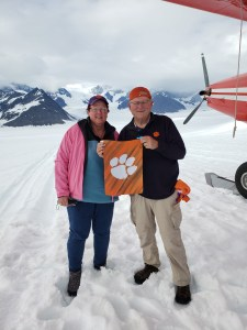 Alaska: Mike Ausherman '78 and his wife, Chris, took a photo with their Tiger Rag after landing on a glacier in Denali National Park.