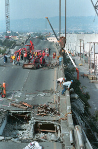 Heavy equipment cranes and backhoes probe and lift debris from the crushed Interstate 880 freeway in Oakland, Ca. on Friday, Oct. 20, 1989. The Bay area was hit with a 7.1 earthquake on Tuesday, causing the two-level freeway to collapse. Over 250 persons were killed. (AP Photo/Paul Sakuma)