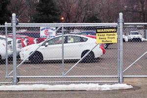 Installing a chain link fence at a auto dealer in Woburn MA