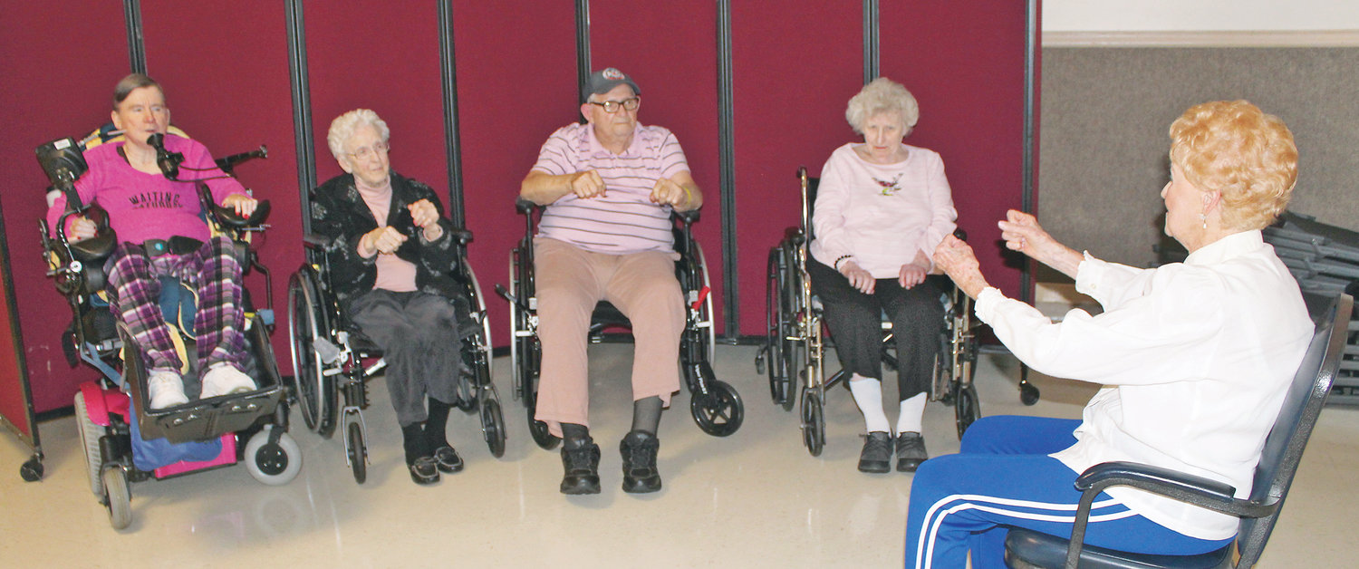 chair exercises for seniors in wheelchairs steelcase jersey bhrc wheelchair bound get exercise program the cleveland daily banner body recall instructor joan baker right goes through a routine