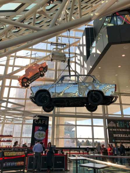 Cars hanging in the Rock and Roll Hall of Fame lobby