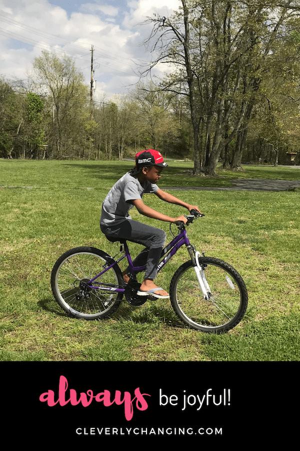 African American Child Riding a Bike-AD Always Be Joyful