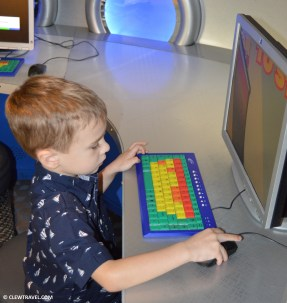 Weston playing computer games in Pixie Hollow