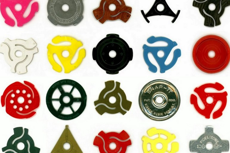 45-rpm single inserts Those old little record spindle adapters