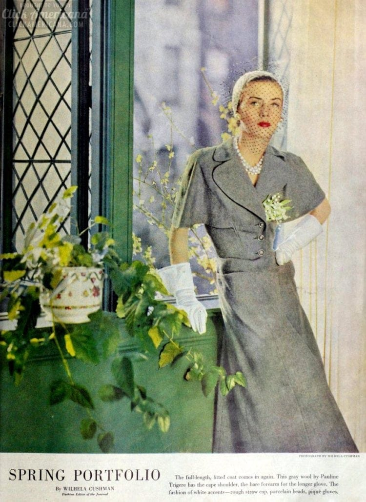 1950s spring fashions for women in gray wool with cape shoulder, the bare forearm for the longer glove