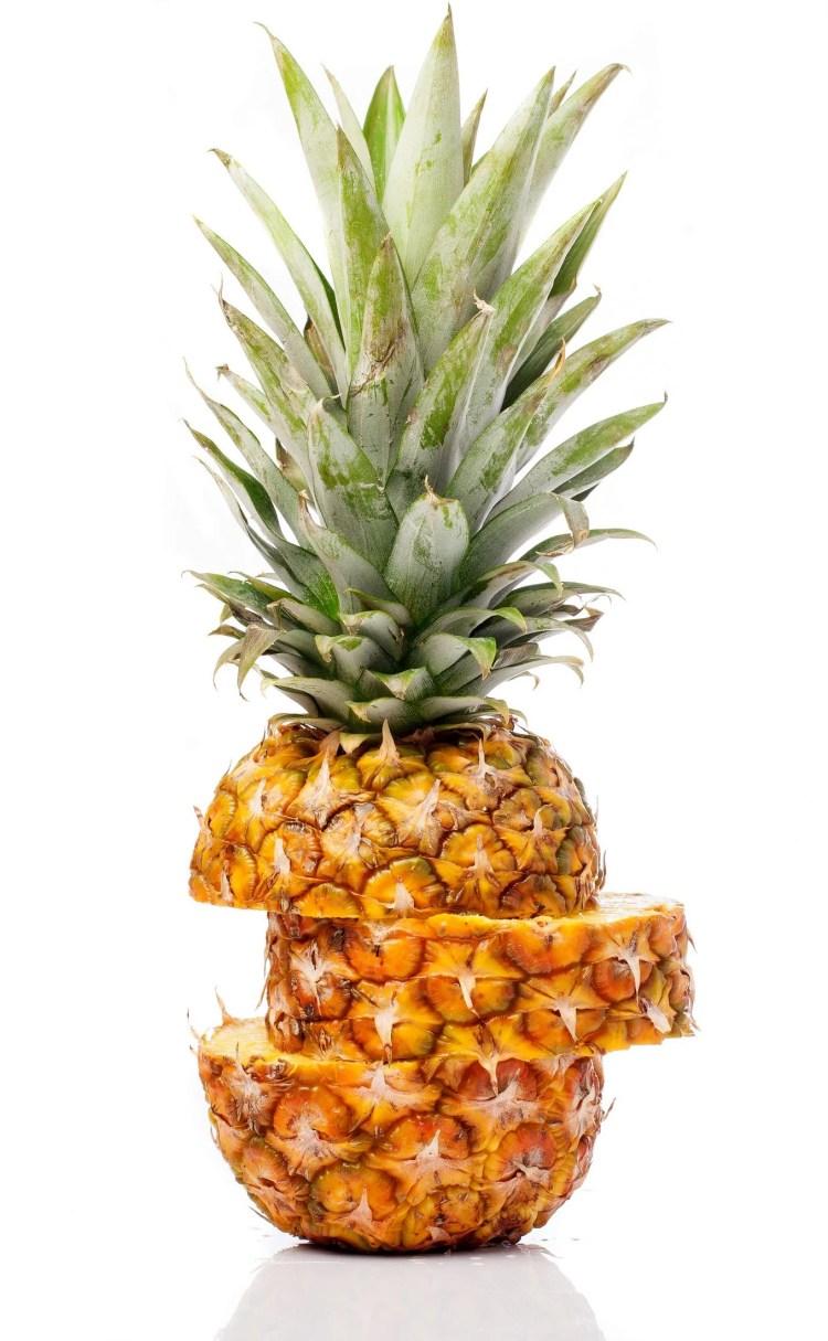 Ripe pineapple sliced across
