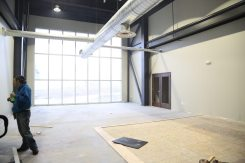 The main space in the gym, with floor to ceiling windows.