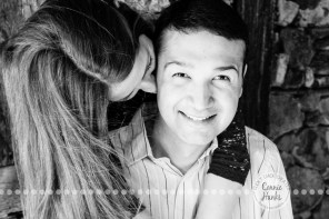 Connie Hanks Photography // ClickyChickCreates.com // engagement couple session, Rosarito, Mexico, mercado, market, colorful, blue, gray, wood, wheel, rustic, arches, archways, kiss, B&W