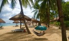 """Our stop at Nha Trang was to do not much more than lie on the beach. The heat made that unappealing and then torrential rain """" washed out"""" any beach activity."""
