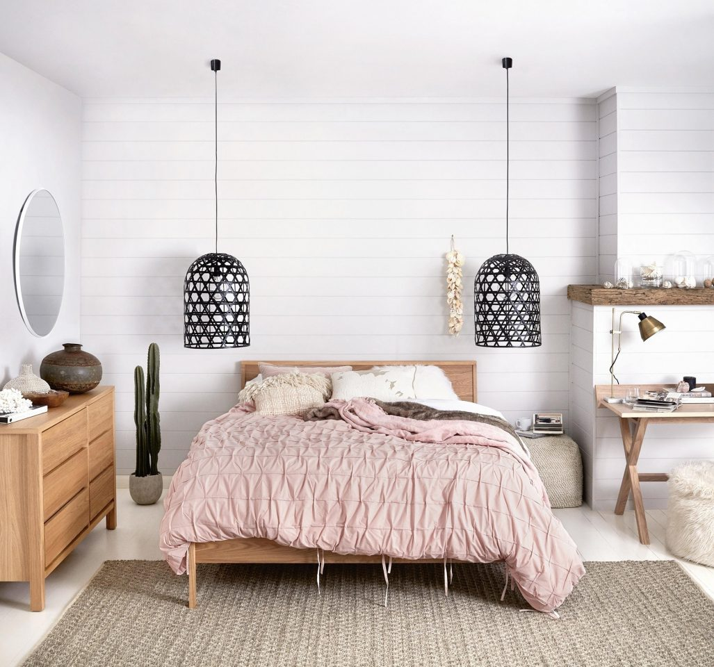 pink bedding and black pendant lights