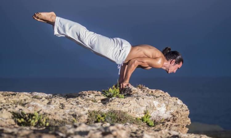 image of balazs heller in yoga balance pose
