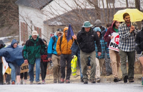 Protesters walk in rain