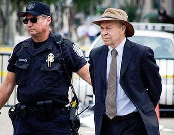 """James Hansen being arrested at a protest against the Keystone XL pipeline, which he calls """"the fuse to the biggest carbon bomb on the planet,"""" because it would carry tar sands crude."""