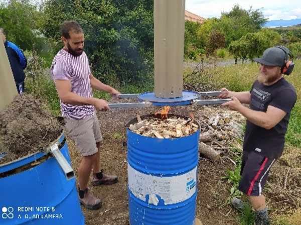 Fig. 3: A.J., a civil contractor and jack-of-all-trades, produced four drums with chimneys for burning wood and biomass to make biochar (Image: Nelson Whakatu Microforest)