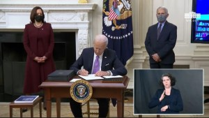 This image has an empty alt attribute; its file name is Biden_signing_a_bill_for_COVID-19_testing-1024x576.jpg