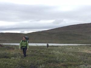Jasmine & Ben hiking in to sample a lake.
