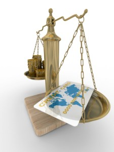 Credit card and coins on scales. Isolated 3D image