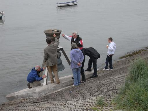 People explore the Time and Tide Bell at Appledore in Devon