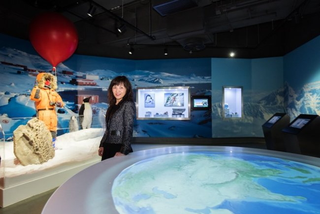 Showing Cecilia Lam, Director of the CUHK Jockey Club Museum of Climate Change