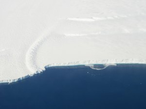 This photo shows the ice front of the ice shelf in front of Pine Island Glacier, a major glacier system of West Antarctica. The image was taken during the NASA/Centro de Estudios Cientificos, Chile (CECS) Antarctic campaign of Fall 2002. Image credit: NASA/JPL-Caltech/UC Irvine