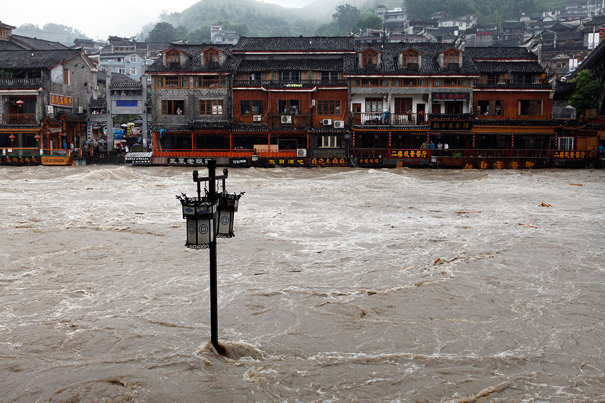 A street lamp is seen in the overflowing river. Reuters