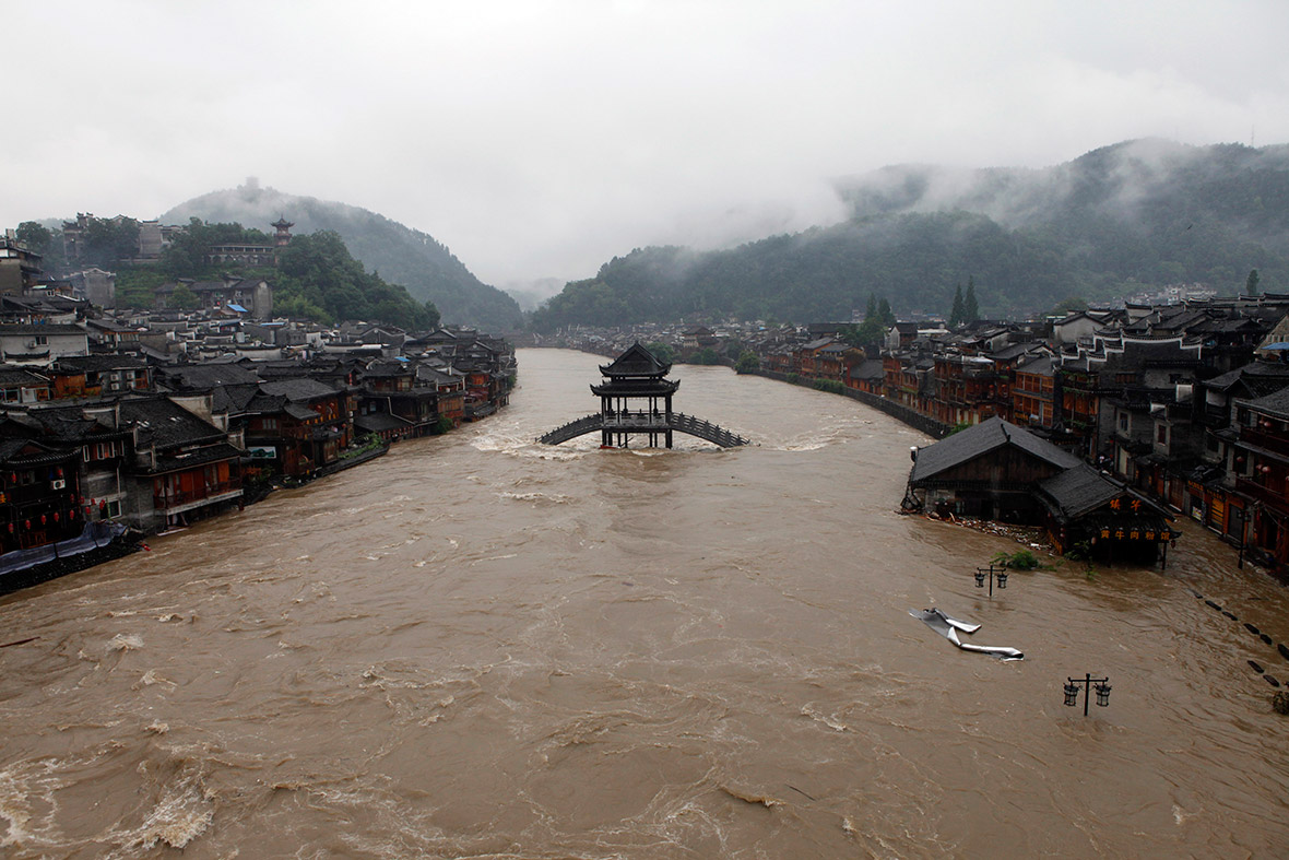 The ancient town of Fenghuang is partially submerged by floodwater as a river overflows in Hunan province, China. Reuters